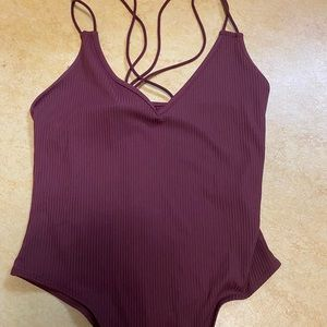 body suit with criss cross straps in back